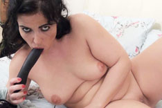 Montse Swinger Playing Solo on the Bed