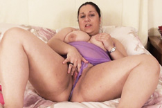 Kim Scott Playing on the Bed