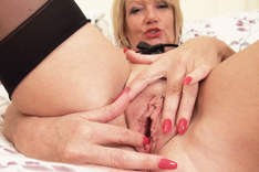 MILF Amy pleasures herself on the Bed